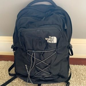 All black north face women's backpack